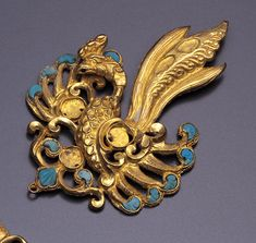 Chinese Hair Ornament, Tang Dynasty (700 - 900 AD). Gold and turquoise.