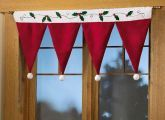 This adorable valance looks like a row of upside-down Santa hats a great alternative to lights or garland. Made of faux suede, it s trimmed with pom poms, appliqus and embroidery.