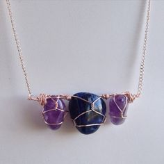 Amethyst and Sodalite were hand selected by the customer for a meaningful birthday gift based on their metaphysical properties.   She pinpointed a couple styles she like that I've made and I compiled them all into this beautiful creation! ❤️ Feel free to message me if you are interested in a similar necklace!   Online Store: HappyMedium4eco.Etsy.com  Custom Orders/Website: www.HappyMedium4eco.com ✨Amethyst✨  ~Calming and purifying improving temperament and alleviating addictions and addict