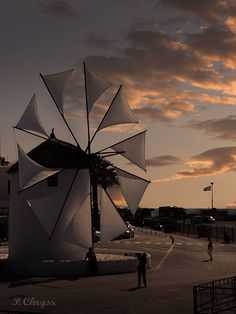 Gorgeous sunset and the windmill at Parikia, the central port of Paros island, Greece. Photography by P. Chryss, Creative Social Media Sitter. Feel free to share, please ask me if you want to use it.