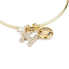 Personalize your own charm bracelet with your initial & favorite gems.