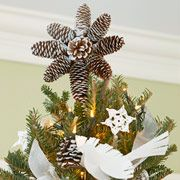 Pine cone tree topper.  Love the look.  I think I would add a piece of sturdy cardboard tube to the back to help anchor this topper to the tree.