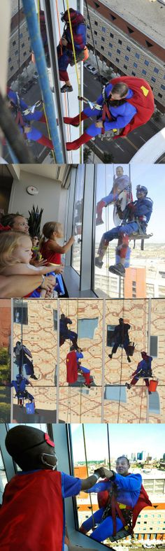 Real world superheroes… look at the little boy dressed as Superman fist-bumping the Superman window washer!!!