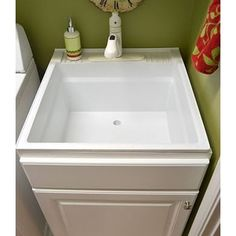 Place a cabinet base around laundry sink
