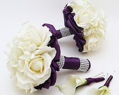 White Real Touch roses, Picasso mini callas and purple Real Touch hydrangea create a lovely custom real touch flower bridal bouquet that can be yours to have and to hold on your wedding day! I can create it for you as shown or customize it to fit your color scheme. We can work together to create a custom silk flower wedding package for your entire wedding party!  This 4-piece wedding flower package includes a bridal bouquet is 9 in diameter and includes Picasso (white with purple center)…