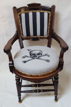 Hand-painted skull and crossbones design on natural linen with bold painted stripes. Detailed with a top hat and a gold tooth and trimmed out with