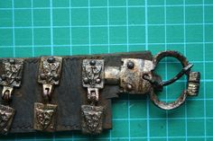 The other side of the belt with the second buckle and full view of the hinged Heraldic motifs (Photo: John Nicholl)