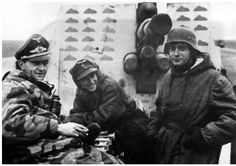 """Caption: """"An 8.8cm FlaK 36 gun crew poses for the camera during a lull in the fighting during the early winter of 1945. Note the guns splinter shield boasting a vast array of painted tanks denoting kills. Although the war was now drawing to a terrible end for the Germans, the 8.8cm FlaK gun still continued to do sterling service right to the end.'"""
