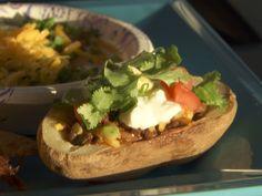 Taco-Stuffed Potato Skins recipe from Trisha Yearwood via Food Network (Season 7 -- Habitat Build) Mexican Dishes, Mexican Food Recipes, Beef Recipes, Cooking Recipes, Potato Recipes, Kitchen Recipes, Vegetable Recipes, Vegetable Dishes, Yummy Recipes