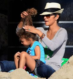 Hair flare: Halle was seen doing her daughter's hair as she showed off ...
