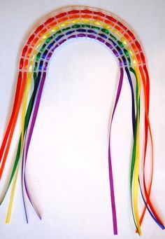 Kid's Craft: How to Make an Easy Rainbow Weaving - whileshenaps.com
