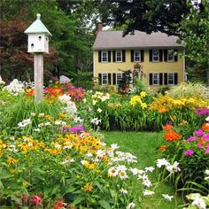 I love the richness and variety of the plantings in this lush garden.  TOH garden winners 2012  Natick, MA