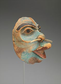 Mask ca. 1825, Alaska Culture: Tlingit Medium: Wood, paint Dimensions: H. 8 1/2 x W. 6 1/2 x D. 6 in. (21.6 x 16.5 x 15.2 cm) Classification: Wood-Sculpture Credit Line: The Michael C. Rockefeller Memorial Collection, Purchase, Mrs. Gertrud A. Mellon Gift, 1966 Accession Number: 1978.412.148