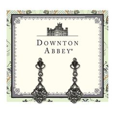 Inspired by the decadent jewelry of the Downton Abbey® ladies, these delicate drop earrings will give your wardrobe some vintage appeal. A feminine filigree fan crafted in a charcoal black tone is accented with petite hematite round cut-crystals. Presented on a Downton Abbey-themed card.
