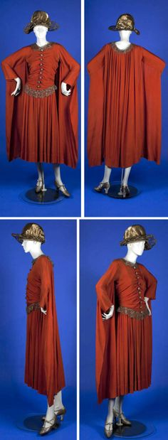 Dark orange silk crepe dress, Poiret, 1922. Bodice has deep V-neckline in back with faux cape. Gold metallic lace collar; 10 metallic thread buttons on bodice. Hook & eye closure in back. Bodice lined in off-white silk; skirt unlined. Sleeves created by folding short side of panel on itself and stitching. Waist seam trimmed with gold metallic lace; pleated at waist seam for fullness. Ohio State Univ.
