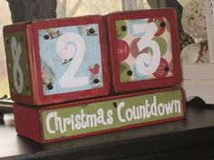 Countdown to Christmas… the key here is the numbers on the blocks: 0, 1, 2, 3, 5, 6 (reversible to 9) on one block, 0, 1, 2, 4, 7, 8 on the other block.