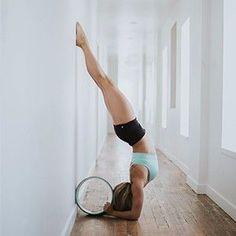 headstand with yoga wheel | yoga