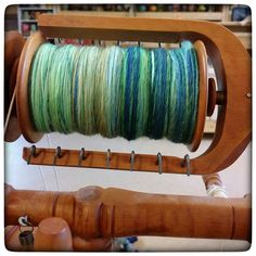 """Today's spinning for the Tour de Fleece. Two more ounces (so four total) on that Finn I started Monday. I love how soft and heathered this looks... I hope it looks that way when I ply it!  As an aside I've really enjoyed participating this time (as opposed to all the other times I've been all """"no! I'm not a joiner!""""). I hadn't really spun much since breaking that finger last year and I'd been sporadic for a year or two before that. Showing up and sitting there every day is rekindling my love…"""