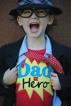 It's a bird… It's a plane… It's an adorable child paying homage to Superdads! Happy Father's Day!
