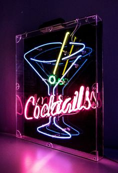 Exposed Neon Cocktails sign mounted within an acrylic casing. Neon Lighting, Bar Lighting, Borderlands Moxxi, Tattoo Wallpaper, Neon Rosa, Cocktail Quotes, Night Bar, Neon Words, All Of The Lights