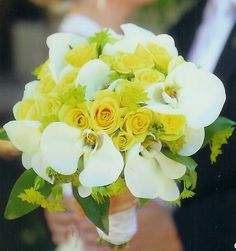 Gorgeous Wedding Bouquet Showcasing: White Phalaenopsis Orchids, Yellow Spray Roses, Green Bupleurum & Green Foliage