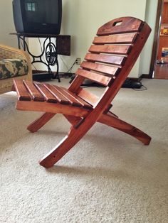 "DIY folding chair- This chair is made out of a shipping pallet and comes apart into two pieces. The part you sit on slides inside the ""back rest"" part of the chair for transport."