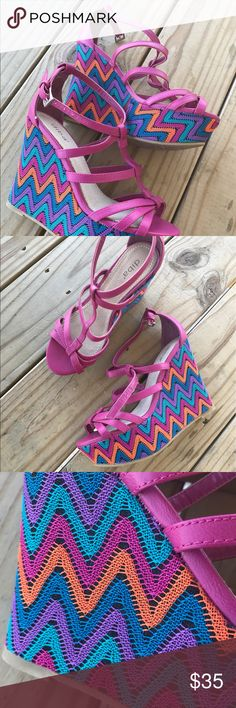 Pink and colorful wedges Lovely deep pink wedge with striped chevron pattern -- orange, blue, purple, teal.  Pattern is knitted on for lovely detailing. Great for summer! Size 7 and in new condition. Diba Shoes Wedges