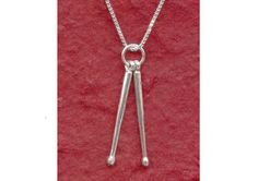 Look @Shanny Bananny Sterling Silver DRUMSTICKS Necklace 925 Drum Sticks Pendant and Chain. $19.95, via Etsy.
