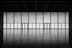 Interior view of the main exhibition space in the Neue Natiobalgalerie by Ludwig Mies van der Rohe.