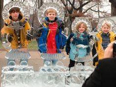 Cleveland, Ohio   Children pose for photos with the ice sculptures at Holiday CircleFest, now in its sixteenth year. This annual holiday event features music, shopping and other activities at Cleveland's University Circle.