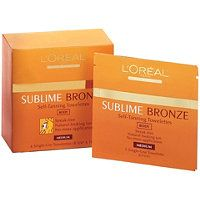 L'Oreal  Sublime Bronze Self-Tanning Towelettes . Can take on the airplane.