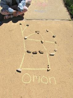 Constellations with rocks and sidewalk chalk.
