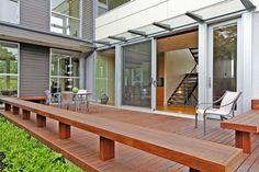 Contemporary Deck with French doors, Advantage Lumber - Brazilian Teak Decking