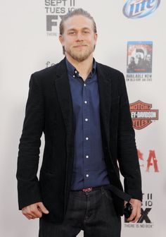 He posed for pictures at the Sons of Anarchy season five premiere | Charlie Hunnam's Superhot Hollywood Evolution in 35 Photos | POPSUGAR Celebrity