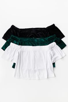 - Soft and shiny velvet crop top - Off-shoulder neckline - Elasticated arm sleeves - Back zipper closure - Available in Black, Emerald Green and White - 95% Polyester 5% Spandex - Imported