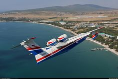 Beriev Be-200 Altair RA-21512 banking over the coast near its home base at Gelendzhik, on the Black Sea coast of Russia. The Altair is a multi-role amphibious aircraft designed for fire fighting, search and rescue, maritime patrol, cargo, and passenger transportation. (Photo: Aleksandr Martynov)