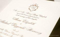 Elegant gold calligraphy on a classic wedding invitation