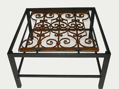 Salvaged wrought iron work adds architectural interest to this glass-topped coffee table.