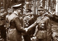Hitler exchanges a handshake with one of his favorite general, Generalobest Eduard Dietl, commanding 3.Mountain Division and, later, general-in-command of the 20th Mountain Army. Popular with the troops and a hard-nosed Nazi, Dietl was killed in a plane accident in 1944.