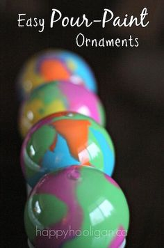 Pour-Painted Christmas Ornaments -  An easy and gorgeous way to decorate a clear glass or plastic ornament. (happy hooligans)