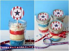 Red white and blue cupcakes layered in mason jars.