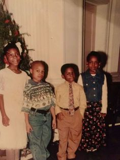 Me, my brother Kelvin, and my our two first cousins who are also siblings. I was about 9 years old, Kelvin (the chubby one) was 7 years old.