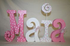 Baby shower decoration 4 wood letters personalized wood letters childrens room decor custom wood letters hand painted nursery décor. $45.95, via Etsy.