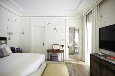 Bedroom of the Swan Lake Suite at #hotelbelair, featuring hand painted butterfly details.