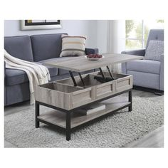 Add a touch of antique style to your sitting area with the apothecary look of the Barrett Lift Up Coffee Table. This table possesses a special lift top feature to create a hidden storage area large enough to keep your remotes, magazines and coasters. If you find yourself working late and want to have a comfy sitting area then take advantage of the Coffee Table's lifting height and get rid of those old TV trays you've been working on. Just place your laptop on the lifted to...