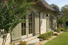 Love the shutters!   Jack Arnold http://jackarnold.com/lifestyle_house/index.html