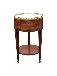 A parquetry table with marble top and gallery, the drum top, with two drawers, over tall tapered legs and a shelf. || TheHighBoy || #highboystyle #antiquesmakeitbetter #antiques #vintage