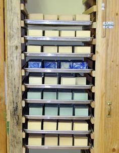 Awesome soap curing closet/shelving.  Bakers trays lined with kraft paper are used for the shelves.