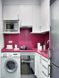 "Small but with all the ""essentials""–sink, fridge, microwave, range, oven, washer. Love the personality added with the bright pink. cozy-and-minimalist-kitchen-interior-decor-with-pink-color.jpg 450×600 pixels"