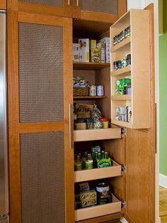 Attach racks to the inside of cabinet doors to boost storage options. Be sure to allow enough clearance within your cabinets to allow the door to close completely. A narrow rack such as this one is ideal for keeping small jars in order - -- pantry door Spice Storage, Pantry Storage, Pantry Organization, Storage Spaces, Spice Racks, Pantry Ideas, Organized Pantry, Door Storage, Kitchen Cabinet Storage